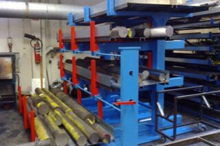 Industrial cantilever rack roll out lever