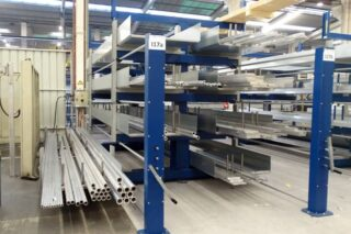 Double sided cantilever rack roll-out drawers
